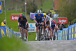 Florian Senechal (FRA) Deceuninck-Quick Step, Tom Pidcock (ENG) Ineos Grenadiers and Olympic Champion Greg Van Avermaet (BEL) AG2R Citroen Team climb the Paterberg during the 2021 Tour of Flanders running 254.3km from Antwerp to Oudenaarde, Belgium. 4th April 221.  <br /> Picture: Serge Waldbillig | Cyclefile<br /> <br /> All photos usage must carry mandatory copyright credit (© Cyclefile | Serge Waldbillig)