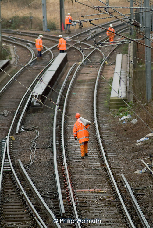 Railway workers employed by a private contractor carry out work on the Silverlink line in Stratford, close to the proposed site of the 2012 Olympic Games in East london.