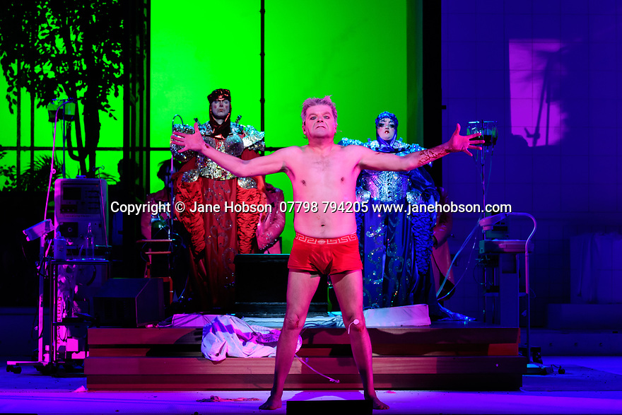 """EMBARGOED UNTIL 23:00 FRIDAY 18 OCTOBER 2019: English National Opera presents """"The Mask of Orpheus"""", by Sir Harrison Birthwhistle, libretto by Peter Zinovieff, at the London Coliseum, in its first London restaging in the 30 years since its premiere, coinciding with the celebration of Sir Harrison's 85th birthday. Directed by Daniel Kramer, with lighting design by Peter Mumford, set design by Lizzie Clachan and costume design by Daniel Lismore. Picture shows: Peter Hoare (Orpheus the Man), Daniel Norman (Orpheus the Myth), Claire Barnett Jones (Eurydice the Myth)"""