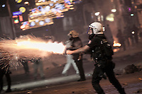In this Saturday, Jun. 15, 2013 photo, policeman fires tear gas canisters against protesters on Istiklal street as clashes spark out after anti-riot police attacked a peaceful rally in Gezi park of Taksim Square during the ongoing turmoil in Istanbul, Turkey. (Photo/Narciso Contreras).