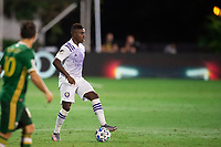 LAKE BUENA VISTA, FL - AUGUST 11: Sebastian Mendez #8 of Orlando City SC dribbles the ball during a game between Orlando City SC and Portland Timbers at ESPN Wide World of Sports on August 11, 2020 in Lake Buena Vista, Florida.