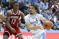 CHAPEL HILL, NC - FEBRUARY 25: Cole Anthony #2, C.J of the University of North Carolina drives past Bryce #13 of North Carolina State University during a game between NC State and North Carolina at Dean E. Smith Center on February 25, 2020 in Chapel Hill, North Carolina.