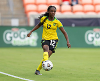 HOUSTON, TX - JUNE 10: Sashana Campbell #12 of Jamaica dribbles the ball during a game between Nigeria and Jamaica at BBVA Stadium on June 10, 2021 in Houston, Texas.