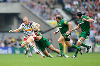 Mike Brown of Harlequins is tackled by Eamonn Sheridan of London Irish during the Premiership Rugby Round 1 match between London Irish and Harlequins at Twickenham Stadium on Saturday 6th September 2014 (Photo by Rob Munro)