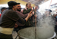 Pictured: Men and women take part in the Bourani custom in which a spinach soup is prepared in Tirnavos, central Greece. 19 February 2018<br /> Re: Bourani (or Burani) the infamous annual carnival which dates to 1898 which takes place on the day of (Clean Monday), the first days of Lent in Tirnavos, central Greece, in which men hold phallus shaped objects as scepters in their hands.