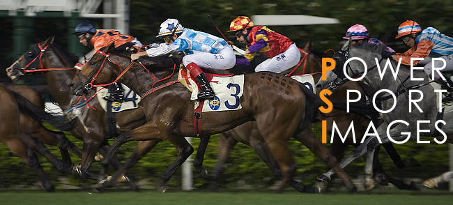 HONG KONG, CHINA - SEPTEMBER 16:  Runners in action in the Race 7 during the first night of horses races of the 2009/10 seasson at the Happy Valley racecourse in Hong Kong. The coming 2009/10 racing season marks the 125th Anniversary of The Hong Kong Jockey Club, which since its establishment in 1884. Photo by Victor Fraile / The Power of Sport Images