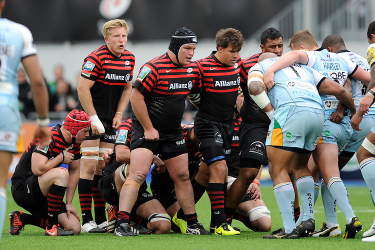 20130512 Copyright onEdition 2013©.Free for editorial use image, please credit: onEdition..The Saracens front row, (L-R) Matt Stevens, Schalk Brits and Mako Vunipola of Saracens, scrums down during the Premiership Rugby semi final match between Saracens and Northampton Saints at Allianz Park on Sunday 12th May 2013 (Photo by Rob Munro)..For press contacts contact: Sam Feasey at brandRapport on M: +44 (0)7717 757114 E: SFeasey@brand-rapport.com..If you require a higher resolution image or you have any other onEdition photographic enquiries, please contact onEdition on 0845 900 2 900 or email info@onEdition.com.This image is copyright onEdition 2013©..This image has been supplied by onEdition and must be credited onEdition. The author is asserting his full Moral rights in relation to the publication of this image. Rights for onward transmission of any image or file is not granted or implied. Changing or deleting Copyright information is illegal as specified in the Copyright, Design and Patents Act 1988. If you are in any way unsure of your right to publish this image please contact onEdition on 0845 900 2 900 or email info@onEdition.com