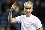 USA's John McEnroe points to the fans for one more point to win the match during the HSBC Tennis Cup series at First Niagara Center in Buffalo, NY on October 22, 2011