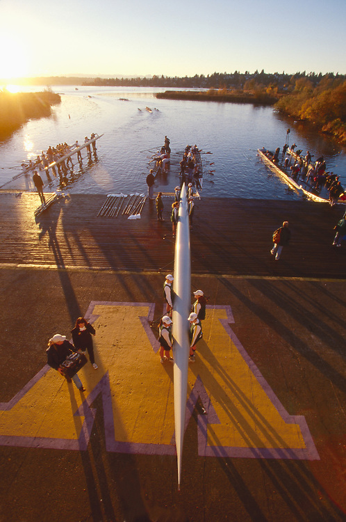 Rowing, regatta, launching eight oared shells, University of Washington, Conibear boathouse, Seattle, Washington, Pacific Northwest, Washington State, USA.