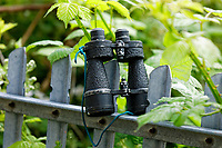 Pictured: A pair of binoculars on the fence of the now dilapidated Swansea Boys Club building in Mayhill, Swansea, Wales, UK. Wednesday 16 June 2021<br /> Re: Riot aftermath in the Mayhill area of Swansea, Wales, UK.