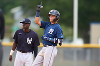 FCL Tigers East Manuel Sequera (15) celebrates hitting a double as second baseman Angel Rojas (19) looks on during a game against the FCL Yankees on July 27, 2021 at the Yankees Minor League Complex in Tampa, Florida. (Mike Janes/Four Seam Images)
