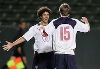 Benny Feilhaber, left, Eddie Gaven, right, celebrate  USA over Trinidad, 6-1, Wednesday, Jan. 12, 2005, in Carson, California.
