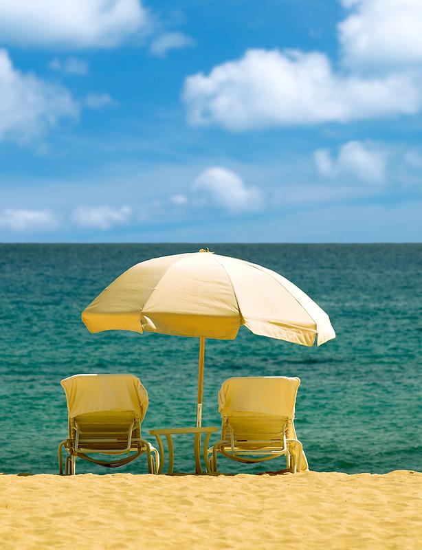 Beach umbrella and chairs. Beach at Four Seasons, Lanai, Hawaii.