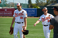 Baltimore Orioles Ryan Ripken (91) and  Jaycob Brugman (85) walk to the dugout before a Grapefruit League Spring Training game against the Detroit Tigers on March 3, 2019 at Ed Smith Stadium in Sarasota, Florida.  Baltimore defeated Detroit 7-5.  (Mike Janes/Four Seam Images)