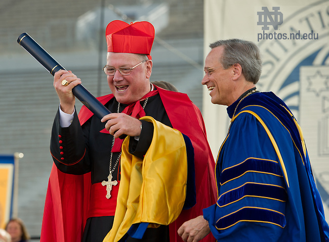 May 19, 2013; Timothy Cardinal Dolan, Archbishop of New York and Commencement speaker, reacts after receiving an honorary doctorate degree at the 2013 Commencement ceremony in Notre Dame Stadium...Photo by Matt Cashore/University of Notre Dame