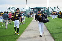 Pittsburgh Pirates Corey Dickerson (12) and Garth Brooks (7) walk to the fields after stretch during the teams first Spring Training practice on February 18, 2019 at Pirate City in Bradenton, Florida.  (Mike Janes/Four Seam Images)