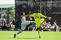 LAKE BUENA VISTA, FL - JULY 13: Ayo Akinola #20 of Toronto FC and Bill Hamid #24 of DC United battle for the ball during a game between D.C. United and Toronto FC at Wide World of Sports on July 13, 2020 in Lake Buena Vista, Florida.