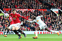 Victor Lindelof of Manchester United competes with Nathan Dyer of Swansea City during the Premier League match between Manchester United and Swansea City at the Old Trafford, Manchester, England, UK. Saturday 31 March 2018