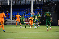 LAKE BUENA VISTA, FL - JULY 18: Darwin Quintero #23 of the Houston Dynamo beats Diego Chará #21 of the Portland Timbers during a game between Houston Dynamo and Portland Timbers at ESPN Wide World of Sports on July 18, 2020 in Lake Buena Vista, Florida.