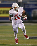 Fresno State's Josh Auezada runs up the middle during the second half of an NCAA college football game against Nevada in Reno, Nev., on Saturday, Nov. 22, 2014. (AP Photo/Cathleen Allison)