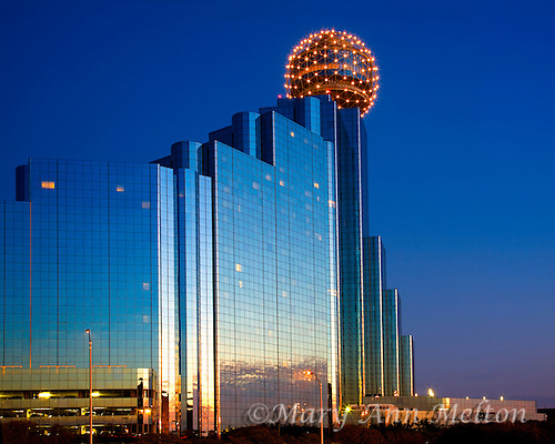 Dallas Hyatt Hotel reflects the sunset sky