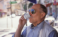 French man drinking coffee in pavement café. Cannes. Cote D'Azur. France.