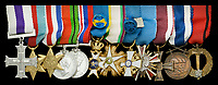 BNPS.co.uk (01202 558833)<br /> Pic: DixNoonanWebb/BNPS<br /> <br /> Pictured: Left to right: Military Cross, 1939-45 Star, France Star, Defence Medal, War Medal, Swedish Order of the Polar Star, Order of Stara Planina of Bulgaria, Order of the White Rose of Finland, Polish Order of Merit, Poland Cross of Valour, Czechoslovakia Medal of Merit and Czechoslovak Medal Abroad.<br /> <br /> The bravery medals awarded to disgraced media tycoon Robert Maxwell for his wartime heroics have today sold for £7,500.<br /> <br /> Decades before the fraudster stole millions of pounds from the pension fund of Mirror Group Newspapers and then drowned in mysterious circumstances, Maxwell was a decorated war hero with a tragic past.<br /> <br /> Maxwell took part in the Normandy invasion and fought across Europe towards Germany. In April 1945 he was awarded the Military Cross for storming a German machine-gun post that had been pinning down British soldiers on the Holland/German border.<br /> <br /> His medals went under the hammer with London auctioneers Dix Noonan Webb.
