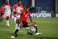 Egypt's Mohamed Talaat (9) attempts to keep control of the ball against Costa Rica's Jose Mena (2) during the FIFA Under 20 World Cup Round of 16 match between Egypt and Costa Rica at the Cairo International Stadium on October 06, 2009 in Cairo, Egypt.