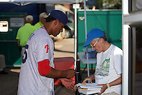 Reading Fightin Phils pitcher Ricardo Pinto (35) signs autographs before a game against the Portland Sea Dogs on May 31, 2016 at Hadlock Field in Portland, Maine.  Reading defeated Portland 6-4.  (Mike Janes/Four Seam Images)