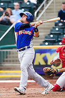 Petey Paramore (7) of the Midland RockHounds follows through on his swing after hitting a fly ball during a game against the Springfield Cardinals on April 19, 2011 at Hammons Field in Springfield, Missouri.  Photo By David Welker/Four Seam Images