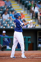 Oklahoma City Dodgers third baseman Buck Britton (4) at bat during a game against the Fresno Grizzles on June 1, 2015 at Chickasaw Bricktown Ballpark in Oklahoma City, Oklahoma.  Fresno defeated Oklahoma City 14-1.  (Mike Janes/Four Seam Images)
