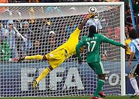 Vincent Enyeama, goalkeeper of Nigeria makes a save against Argentina