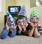 Party ideas for New Year's Eve with the kids.  Jennifer Miller comes up with the ideas.  Wearing hats and glasses that Jennifer made, are Tate Miller, 4, left, Dylan Prestwich, 6, and Henry Miller, 6.  (ELLEN JASKOL/ROCKY MOUNTAIN NEWS)