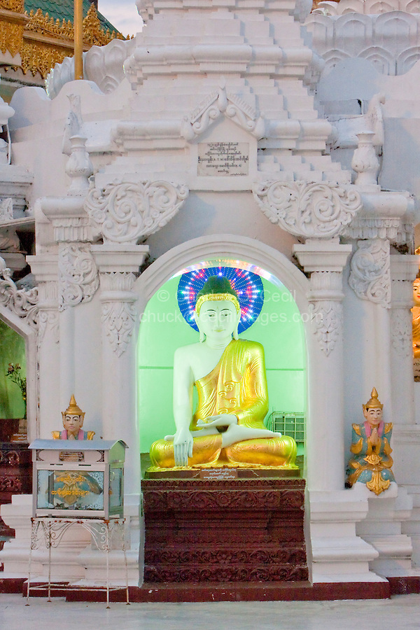 Myanmar, Burma.  Shwedagon Pagoda, Yangon, Rangoon.  Small Buddha Shrine with the Buddha demonstrating the mudras (hand gestures) of earth-touching (bhumisparsha) and wisdom (dhyana).