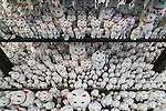 Thousands of Maneki-Neko figurines on display at Goutoku Temple on January 26, 2016 in Tokyo, Japan. The temple and the surrounding area is well known for its massive collection of Maneki-Neko, literally beckoning cats. The cats  are a common Japanese charm thought to bring good luck to the owner. They are often displayed at the entrance to shops and restaurants but Goutoku Temple goes one further and displays over 1000 cats throughout its ground. (Photo by Rodrigo Reyes Marin/AFLO)