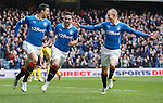 Haris Vuckic celebrates his goal with Nicky Clark and Kenny Miller
