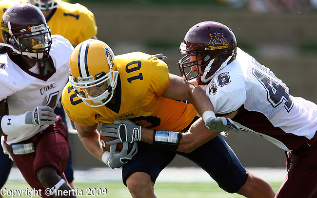 SIOUX FALLS, SD - SEPTEMBER 12:  Joe Klumper #10 of Augustana splits the defense of Chris Wooding #4 and Cody Brekken #46 of Minnesota Crookston in the second quarter Saturday afternoon at Kirkeby-Over Stadium. (Photo by Dave Eggen/Inertia).