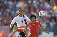 Clint Dempsey and Zhang Yaokun eye the ball. The USA defeated China, 4-1, in an international friendly at Spartan Stadium, San Jose, CA on June 2, 2007.