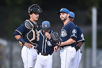 Asheville Tourists starting pitcher Tyler Chatwood and catcher Dom Nunez (9) have a discussion during game 3 of the South Atlantic League Championship Series between the Asheville Tourists and the Hickory Crawdads on September 17, 2015 in Asheville, North Carolina. The Crawdads defeated the Tourists 5-1 to win the championship. (Tony Farlow/Four Seam Images)