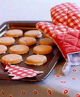 A tray with freshly baked iced cookies