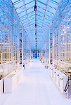 September 9, 2014. Research Triangle Park, North Carolina.<br />  Looking down the main corridor of the greenhouse. Along each side are individually controlled environments for different experiments.<br /> The Syngenta Advanced Crop Lab is nearly one acre of advanced agricultural research under glass. The lab is capable of maintaining many different environments under its roof, allowing scientists to test the effects of various environmental elements on different crops and plants side by side.