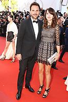 Christophe Michalak et Delphine McCarty sur le tapis rouge pour la projection du film en competition OKJA lors du soixante-dixiËme (70Ëme) Festival du Film ‡ Cannes, Palais des Festivals et des Congres, Cannes, Sud de la France, vendredi 19 mai 2017.