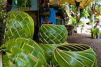Quaint gift shops and local cafes invite tourist driving along the famous Road to Hana, Maui. Here, handcrafted Ti leaf baskets are for sale to visitors.