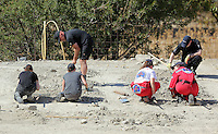 Pictured: Special forensics police officers assisted with Hellenic Red Cross volunteers use rakes to search through soil in a field in Kos, Greece. Tuesday 04 October 2016<br />Re: Police teams led by South Yorkshire Police, searching for missing toddler Ben Needham on the Greek island of Kos have moved to a new area in the field they are searching.<br />Ben, from Sheffield, was 21 months old when he disappeared on 24 July 1991 during a family holiday.<br />Digging has begun at a new site after a fresh line of inquiry suggested he could have been crushed by a digger.