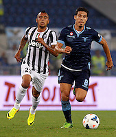 Calcio, Supercoppa di Lega: Juventus vs Lazio. Roma, stadio Olimpico, 18 agosto 2013<br /> Lazio midfielder Hernanes, of Brazil, right, is chased by Juventus midfielder Arturo Vidal, of Chile, during the Italian League Supercup football final match between Juventus and Lazio, at Rome's Olympic stadium,  18 August 2013.<br /> UPDATE IMAGES PRESS/Riccardo De Luca