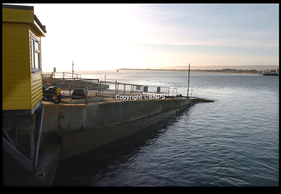 BNPS.co.uk (01202 558833)<br /> Pic: DanielRushall/BNPS<br /> <br /> ***Please Use Full Byline***<br /> <br /> Sandbanks Ferry slipway, Poole, Dorset.  <br /> <br /> An elderly woman has today been rescued from her sunken car after she 'deliberately' drove into a harbour in front of stunned <br /> day-trippers.<br /> <br /> The motorist, aged in her 70s, wound down both windows of her Volkswagen Golf before speeding down a ferry slipway and into the water.<br /> <br /> As the silver car was swept 100 yards out to sea by the fast tide the woman sat motionless in the flooded driver's seat, ignoring cries from witnesses on the quayside to get out.<br /> <br /> A brave crew member of a passing fishing boat then dived into the water and pulled the woman free just moments before her vehicle completely sank.