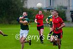 Knocknagoshel's Shane O'Connell passes of the ball ahead of Tarbert's Shane  Enright in their  Junior county Championshio game in Tarbert on Sunday last.