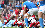 Mike Phillips looks for options from the back of the ruck..2012 RBS 6 Nations.Wales v Italy.Millennium Stadium..10.03.12.Credit: STEVE POPE-Sportingwales