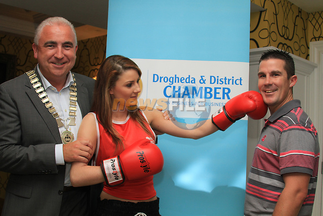 Padraig Kierans holds back Niamh Grogan as she tried to Box Damien McKenna  at the Launch of the White Collar boxing Fight Night in the West Court Hotel...Picture Fran Caffrey www.newsfile.ie