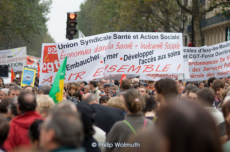 Health workers join a mass demonstration in Paris against a new work contract, introduced by Prime Minister Dominique de Villepin, that allows companies with fewer than 20 employees to fire them within two years instead of six months.